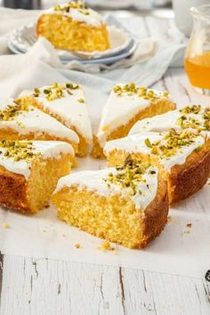 Greek Orange Semolina Cake with an Orange Syrup - Soft, luscious and bursting with orange flavour, this Greek Orange Semolina Cake is an absolute treat. Finish it with Greek yoghurt and a delicious orange syrup for a luxurious tea time cake. Greek Sweets, Greek Desserts, Köstliche Desserts, Delicious Desserts, Desserts With Oranges, Health Desserts, Semolina Recipe, Semolina Cake, Tea Recipes