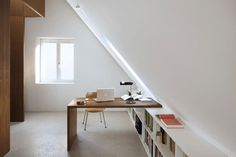 Bright attic with interesting desk for an office space - Decoist