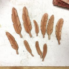 Feathers. Pendants. Leather. Leather feathers. Where could you go wrong? #leather #handmade #feathers