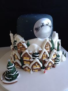 Check out this wonderful Santa Clause is coming to town Christmas cake - For all your cake decorating supplies, please visit craftcompany.co.uk