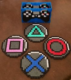 Gamers out there will be fans of Jason‏'s Playstation controller coasters to r. Gamers out there will be fans of Jason‏'s Playstation controller coasters to rest his cup of te Hama Beads Coasters, Diy Perler Beads, Perler Bead Art, Pearler Beads, Hama Beads Kawaii, Melty Bead Patterns, Hama Beads Patterns, Beading Patterns, Peyote Patterns