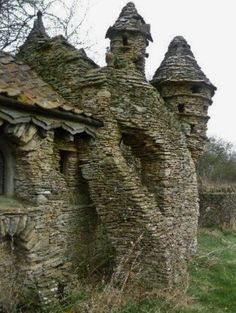 "Abandoned and decayed ""Hobbit House"" built by Colin Stokes in Chedglow, Wiltshire, England. The Hobbit House was a sheep shed built without permission by a local artist, the sprawling construction took nearly ten years to build. Abandoned in the Abandoned Castles, Abandoned Mansions, Abandoned Buildings, Abandoned Places In The Uk, Interesting Buildings, Beautiful Buildings, Beautiful Places, Modern Buildings, Amazing Architecture"