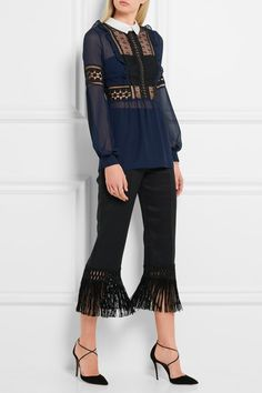 SELF-PORTRAIT Guipure lace and georgette blouse $340 Self-Portrait is known for its tactile take on solid and sheer textures. Cut for a slim fit, this navy georgette blouse is detailed with pretty black guipure lace panels and a crisp cotton-twill collar - we like that it's lined at the bust for coverage. Wear yours with cropped pants or midi skirts.  Shown here with: Edun Pants, Aquazzura Pumps, URiBE Bracelets, Eddie Borgo Ring.