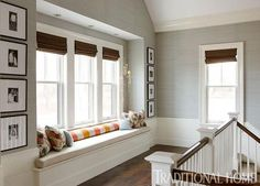 Lovely New England Summer Home with Neutral Palette - Window Seat at the top of the stairs.  Traditional Home