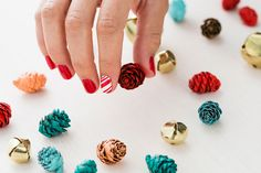 Get into the holiday spirit with candy cane nails.