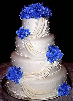 White Wedding Cakes Blue Wedding Cake Ideas - A collection of the best wedding cakes that will definitely inspire you. Various styles, decorations, blue hues, and tier numbers are available. Beautiful Wedding Cakes, Gorgeous Cakes, Pretty Cakes, Amazing Cakes, Royal Blue Wedding Cakes, Wedding Blue, Trendy Wedding, Wedding Shoes, Wedding Flowers