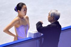 TOKYO, JAPAN - NOVEMBER 08:  Mao Asada of Japan has a moment with her coach during day one of ISU Grand Prix of Figure Skating 2013/2014 NHK...