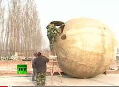 """Big Apocalypse Balls: Chinese Invention To Defend Against Doomsday (You May Wish You Had A Pair)     Camouflage-clad former farmer and furniture maker Liu Qiyuan, 45, inspected his latest creation, a sphere several metres tall he calls """"Noah's Ark"""", designed to withstand towering tsunamis and devastating earthquakes.  See the video"""