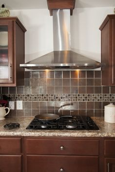 pg306a pinecrest modular ranch kitchen stainless range hood with decorative backsplash