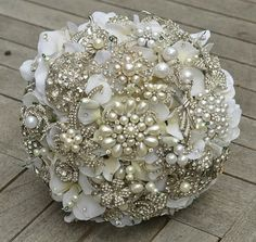 vintage brooch bridal bouquet, my idea is to have each bridesmaid select a vintage broach!