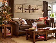 Living Room Ideas & Living Room Decorations - Pottery Barn. Love the aeroplane art on the wall.