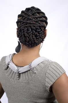 Silky flat twists with squiggly bun.