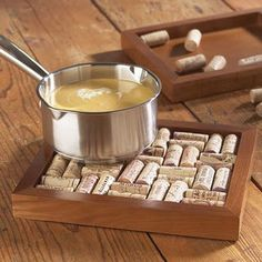 """Wine cork trivet. Use a picture frame, use a tray. Cut a cork into 1/4"""" slices & glue to bottom so it doesn't scratch table (if rough bottom)."""