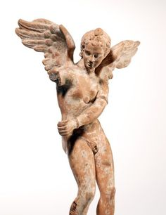 Eros cocks his bow - terracotta marble, from Myrina in Anatolia, circa 200 BCE, Hellenistic period, height 20 cm