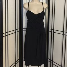 Black gathered dress Black gathered dress! So cut criss crosses in the fronts then gathers to one hip and in the back!  Beautiful! Goodies Dresses Midi