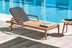 Designed by Patrick Norguet, Knit mixes teak or mahogany wood with a woven synthetic fabric to achieve a sophisticated family of outdoor furnishings.