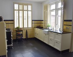 Our new house: the kitchen - Anne Travel Foodie Green Kitchen, New Kitchen, Small Stove, Yellow Tile, Wooden Shutters, Kitchen Stories, Cabinet Space, Foodie Travel, Classic White