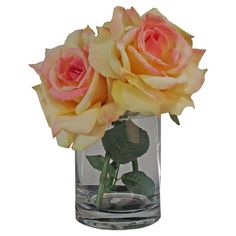 Silk rose arrangement in a clear glass vase with faux water.  Product: Faux floral arrangementConstruction Material:...