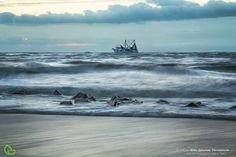 Sunrise with a shrimp boat at Vilano Beach, north of St. Augustine by Robin Anderson Photography, Florida landscape.