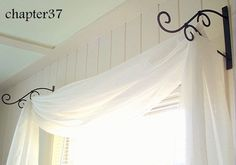 Use plant hangers instead of a curtain rod with a long, sheer fabric