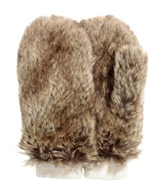 Faux fur mittens with ribbing at cuffs and a fleece lining.