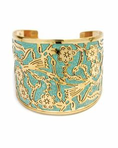 This reminds me of Asia, gold flower cuff bracelet