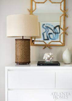 In the guest master bedroom, an Arteriors lamp and Serena & Lily mirror embrace the tropical environs.