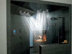 Some of these showers look amazing!!! It's my dream to someday have a huge jetted tub and a fancy shower with 2-3 shower heads.