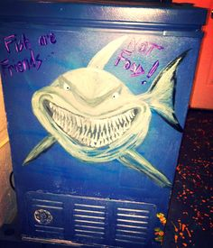 Finding Nemo Artwork - Bruce We love how we updated our pool house by painting underwater themed art on walls and appliances.