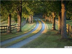 – a winding, tree-lined road and woodstock fence can only lead to a rustic farmhouse.