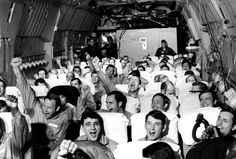 Newly freed prisoners of war celebrate as their C-141A aircraft lifts off from Hanoi, North Vietnam, on Feb. 12, 1973, during Operation Homecoming. The mission included 54 C-141 flights between Feb. 12 and April 4, 1973, returning 591 POWs to American soil. (U.S. Air Force/History By ZIm)