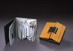 "Grid Modulation by Anne-Claude Cotty. Book with box: birch, found metal, turpentine transfers, colored pencil.  Shaped pages with double spine. (Box measures 7.3"" x 7.3"" x 1""). Collection of Boston Public Library"