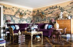 """Alex freely mixes pieces of diverse origins, from Indian textiles to chinoiserie sculptures: """"It creates this grand bohemian atmosphere that I like so much."""" The ceramic wall brackets were commissioned from artist Eve Kaplan."""