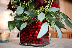 """April 17, 2009 by aashleyt project wedding:   """"Brilliant berries pop in cubic glass vases""""  rustic red austin texas wedding   photo by: Katherine O'Brien"""
