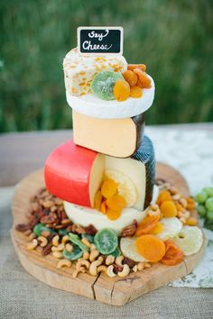 colorful cheese wedding cake / http://www.deerpearlflowers.com/rustic-wedding-cakes-tend-cheese-wedding-cakes/