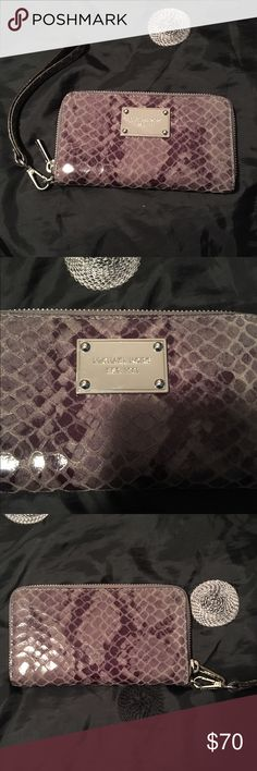 Michael Kors wristlet Authentic snake print leather Michael Kors wristlet. The exterior snake print is shades of gray. The hardware is silver. The interior is gray leather, as well. Many compartments inside! With the removable wristlet strap, this MK item can turn into a wallet. Great condition! Michael Kors Bags Clutches & Wristlets