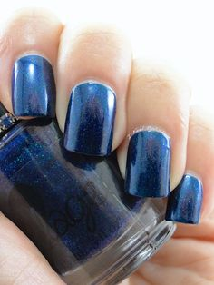 """<a href=""""/faq"""" target=""""_blank""""><img src=""""https://dzasv7x7a867v.cloudfront.net/product_photos/15911567/opactiy3_original.jpg"""" border=""""0""""></a>  Birthstone polish for the September babies!  One full sized 15 ml bottle of Glimmering Sapphire, a deep blue jelly swimming with blue shimmer.   Jewe..."""