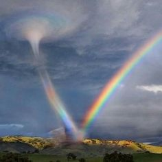 Tornado as it hits a rainbow. The color going up into the tornado is Stunning. Nature is Amazing (Click Photo for more Photos) Beautiful Sky, Beautiful Landscapes, Beautiful World, Beautiful Disaster, Pretty Pictures, Cool Photos, Amazing Pictures, Amazing Nature Photos, Beautiful Nature Pictures