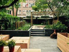 garden design, tuinontwerp, siergras, lounge, tuin, zwarte schutting