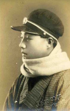 Young Japanese man in cap and scarf. Taisho period
