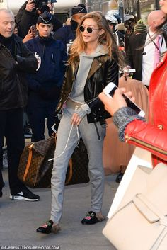Sporty: Gigi Hadid arrived in a grey tracksuit for her second ever Fashion Show...