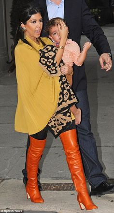 Kourtney Kardashian, boyfriend Scott Disick and son Mason all step out in matching orange | Daily Mail Online