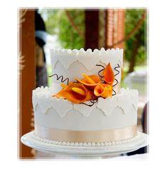 Orange calla lily on white wedding cake
