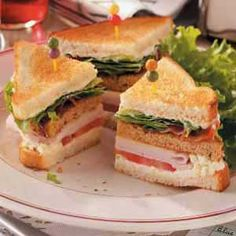 """Blue Cheese Clubs Recipe -""""These sandwiches look so elegant, but they're really easy to make,"""" says Nancy Jo Leffler, DePauw, Indiana. """"They're loaded with plenty of turkey, and the blue cheese spread offers a nice zip."""" —Nancy Jo Leffler, DePauw, Indiana"""