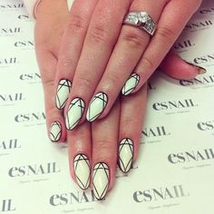 White nails with elegant geometric shapes