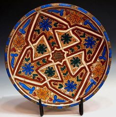 Large Moroccan antique polychrome decorated bowl with arabesque motif.