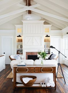 Love the white detail on the sofa table. Makes it pop and is so fresh looking.
