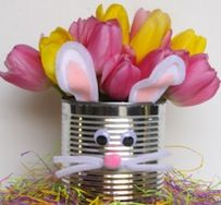 Easter bunny tin vase:  Glue, scissors, cut Tulips, tin can, white & pink felt, 2 white pipe cleaners, googly eyes, pink pom pom, excelsior.