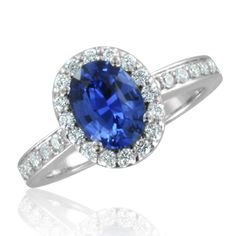 Halo Set Ceylon Sapphire Ring in Platinum 2.04 cttw, 8x6mm. Sapphire ring showcases an oval Ceylon  Sapphire set in platinum channel diamonds halo ring. This sapphire gemstone ring with a matching diamond wedding ring will be a perfect bridal set. -- I'm not much for bling, but this ring is gorgeous and in my favorite color.