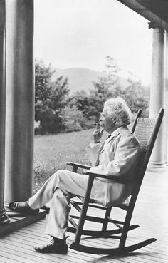 Mark Twain relaxing on a porch in Dublin, New Hampshire, Taken in the author relaxes in a rocking chair on a porch in Dublin, New Hampshire, smoking a cigar. Source: New York Times photo archive Famous Men, Famous People, Mark Twain Quotes, Rare Historical Photos, E Mc2, Writers And Poets, Lectures, Book Authors, Books
